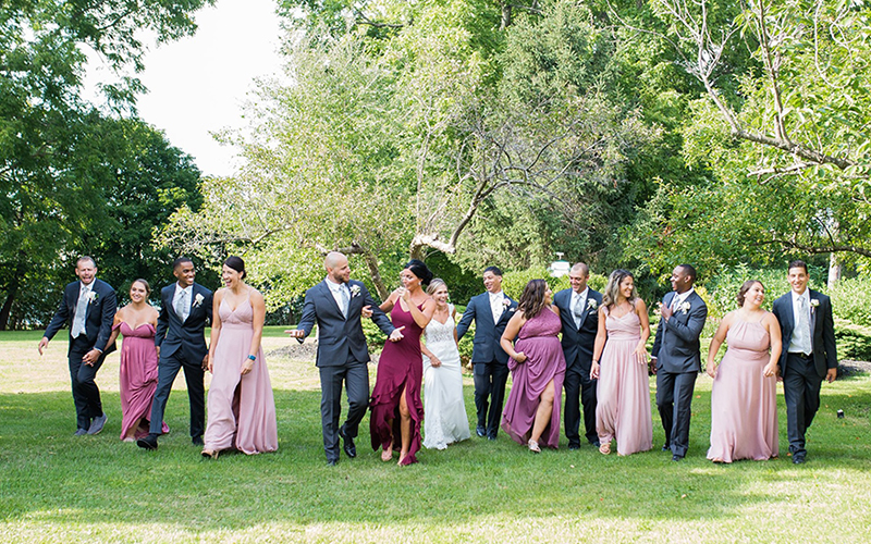 happy wedding party in lawn at Oaks Manor Churchville NY